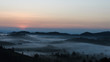 The sunrise with a fog in winter
