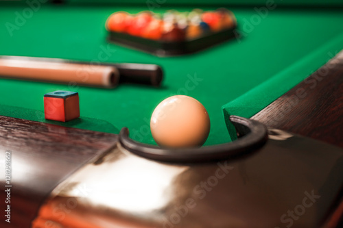 Photo Billiard ball opposite to a pocket.