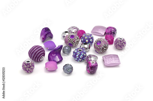 Fotografie, Obraz  Decorative colorful beads scattered on white background - accessories for handma