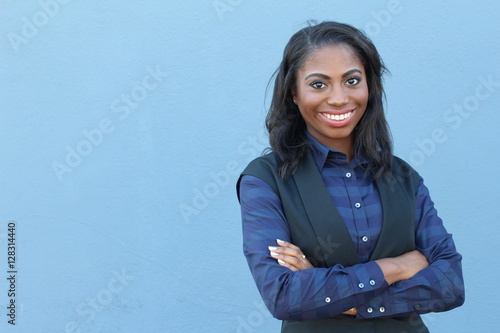 Fototapety, obrazy: Portrait beautiful smiling young african woman with arms crossed - Stock image