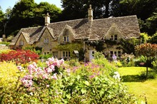 English Country Cottage In The Sunshine In Cotswolds, England, UK