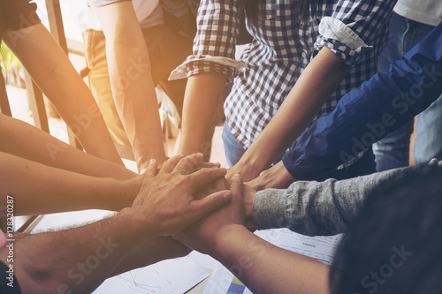 Fotografía  Business people join hand together during their meeting