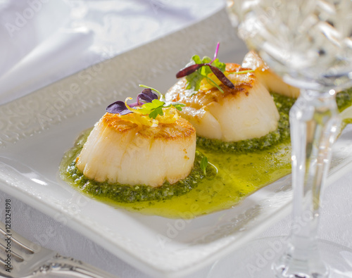 Poster Coquillage Scallops and Pesto Sauce with Micro-Greens served on a White Serving Tray