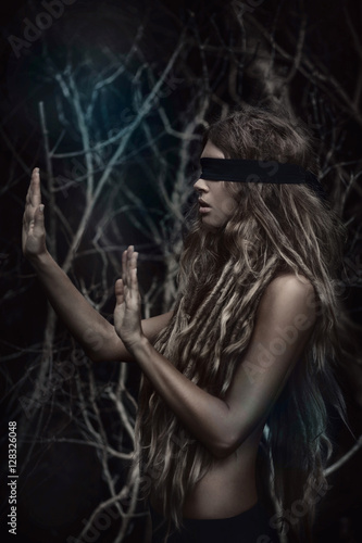 Fotografie, Obraz  Young beautiful blindfolded woman in forest