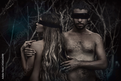 Fotografie, Obraz  atrractive young man and woman with eyes closed. lost in forest.