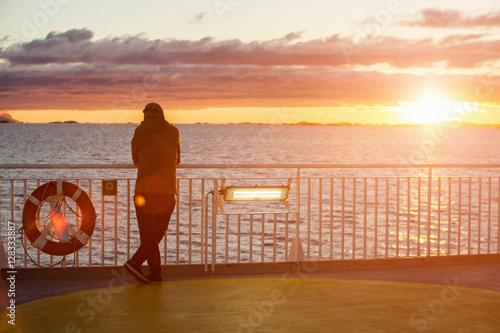 Fotografie, Obraz  Man on the ferry ocean sunset