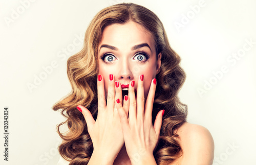 Fotografie, Tablou Woman surprise holding hands at the mouth