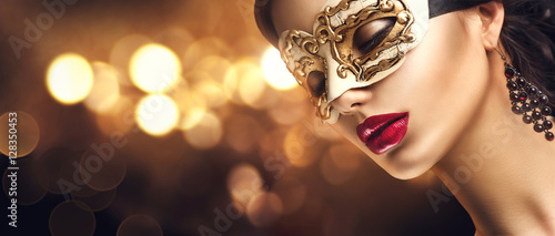 Canvas Prints Carnaval Beauty model woman wearing venetian masquerade carnival mask at party. Christmas and New Year celebration