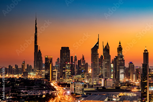 Fotografie, Tablou  A beautiful Skyline view of Dubai, UAE as seen from Dubai Frame at sunset showin
