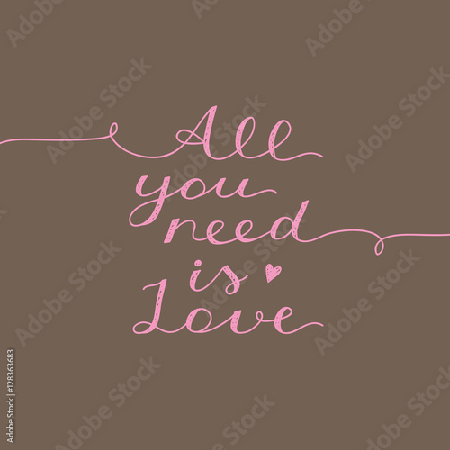 Photo  all you need is love, vector lettering on brown background