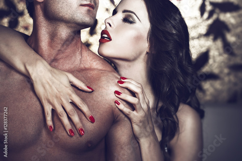 Stampa su Tela Sensual lustful woman with red lips embrace sexy man body
