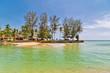 Exotic tropical island under blue sky.