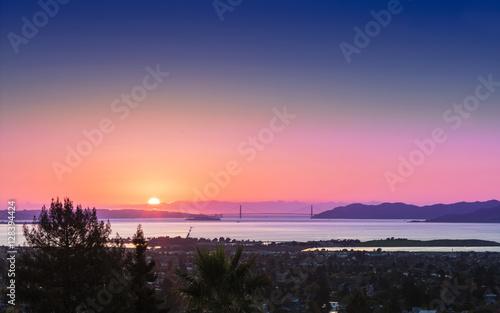 Panorama sunset view of San Francisco Golden Gate Bridge and Berkeley