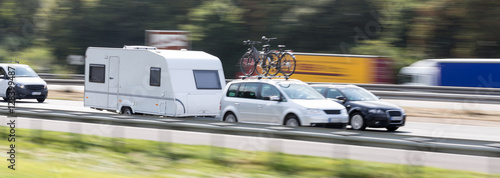 Fototapeta car with a caravan highway speed blur