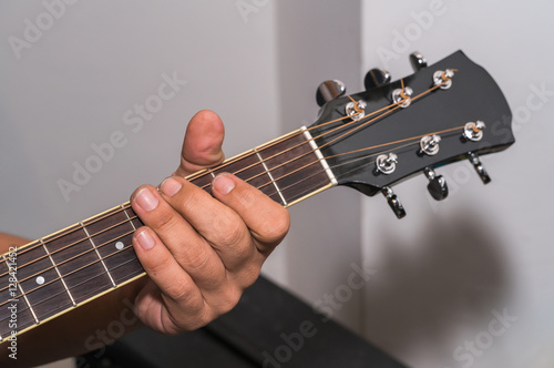 Fotografering  Man playing guitar , close up