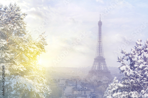 Spoed Foto op Canvas Parijs Christmas background : Aerial view of Paris cityscape with Eiffel tower at winter sunset in Paris. Vintage colored picture. Business, Love and travel concept