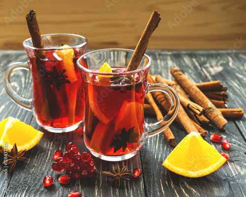 Fotografie, Obraz Hot mulled wine with apples, pomegranate, orange, anise and cinn