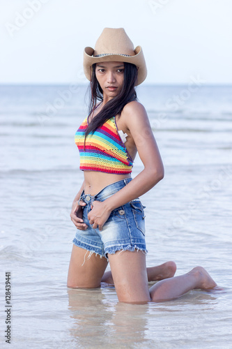 c528e3a8e63c0 attractive woman in a cowboy hat posing in the sea - Buy this stock ...