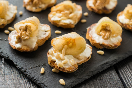 Canape with ricotta cheese, pears, nuts and honey
