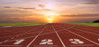 canvas print picture - Running track with lanes over sky and clouds.