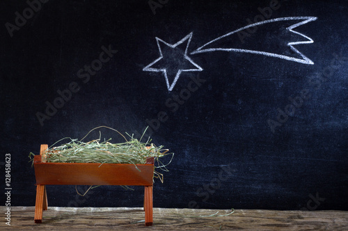 Fotografie, Obraz  Birth of Jesus with manger and star on blackboard abstract christmas nativity sc