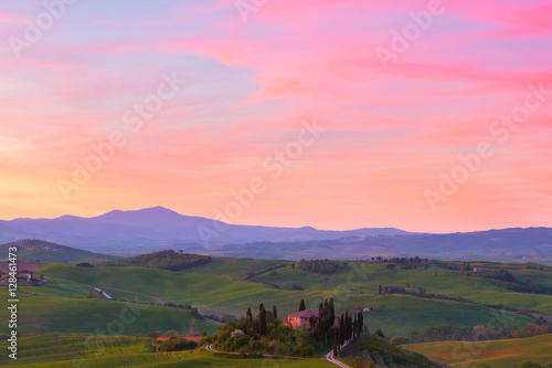 Foto op Aluminium Oranje Typical Tuscany landscape springtime at sunset in Italy