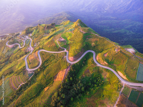 Foto op Aluminium Luchtfoto Aerial view of crooked path of road on the mountain, Shot from d