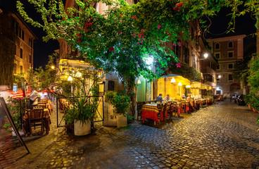 Fototapeta Night view of old street in Trastevere in Rome, Italy