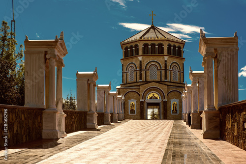 Deurstickers Cyprus Famous orthodox monastery of Kykkos, Holy monastery of the Virgin of Kykkos in Cyprus. Way to the church near king Macarius grave. Travel sightseeing image