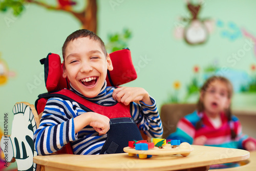 Fototapeta  cheerful boy with disability at rehabilitation center for kids with special need