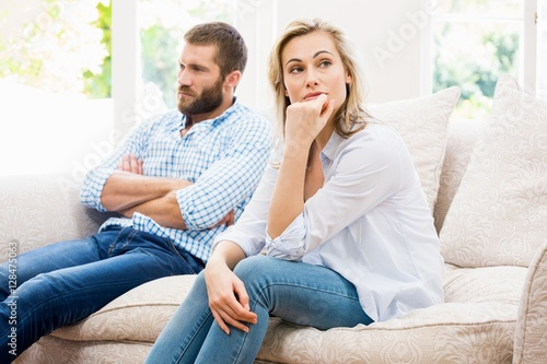 Fotografie, Obraz  Young couple ignoring each other in living room