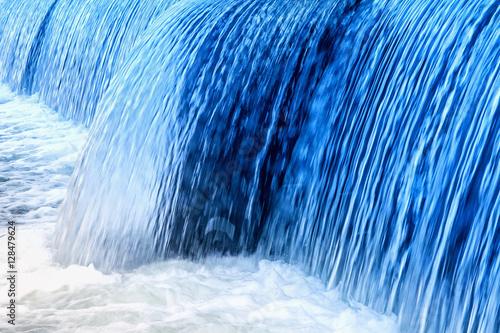 Küchenrückwand aus Glas mit Foto Wasserfalle Blue-colored small waterfall in the wild