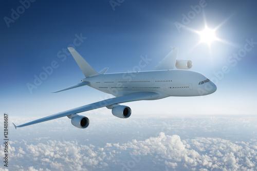 Zdjęcie XXL Duży samolotowy latanie nad chmury z słońcem w niebieskim niebie
