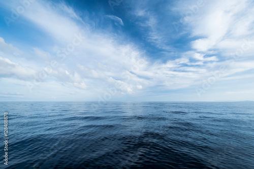 Fototapeta Open ocean and cloudy sky obraz