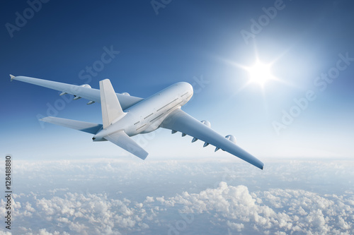 Poster Avion à Moteur Big plane flying towards with the sun in blue sky