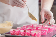 Pouring Cake Mix Into Baking Muffins Tray