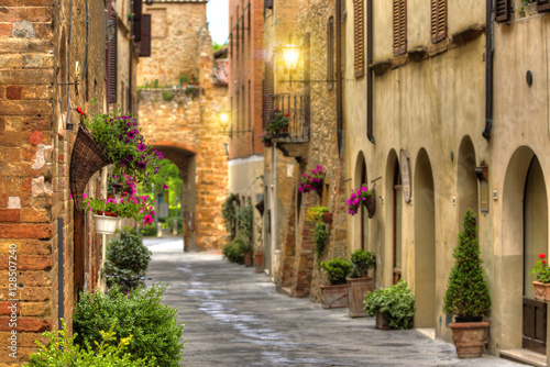Flowery streets on a spring day in a old village Pienza.