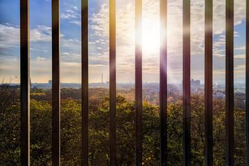 Skyline of Berlin seen through bars, Humboldthain