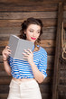 Sailor girl with striped copybook and sailor's striped vest