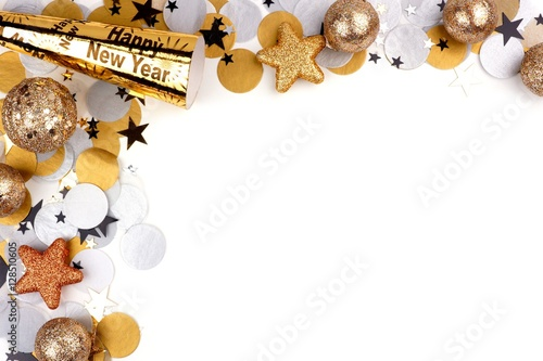 Photo  New Years Eve corner border of confetti and decor isolated on a white background
