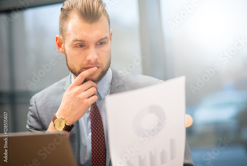 Portrait of a businessman reading a document