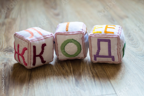 Fotografie, Obraz  tissue blocks with embroidered letters of the Cyrillic alphabet