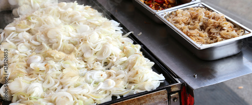big pile of onions  in the street stall