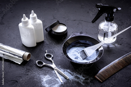 Photo  hair dye with brush on dark background