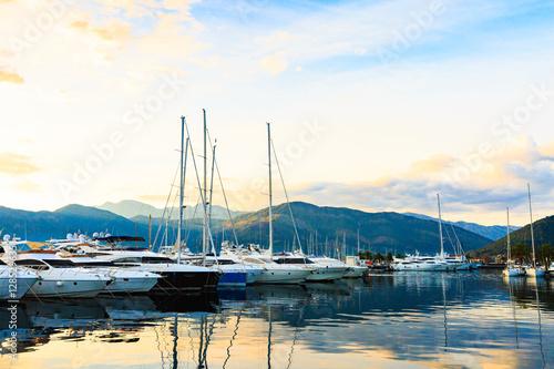 Obrazy na płótnie Canvas Luxury yacht marina. Port in Mediterranean sea at sunset.
