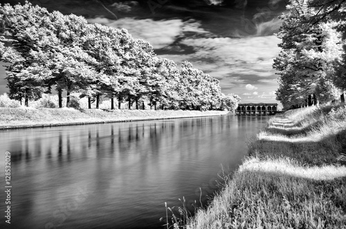 infrared long exposure forest, river and dike