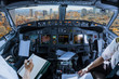 Airplane cockpit flying on San Francisco Financial District Downtown, California, United States, with pilots arms and blank white papers for copy space.