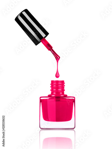Fotografía  Nail polish dripping from brush into bottle on white background