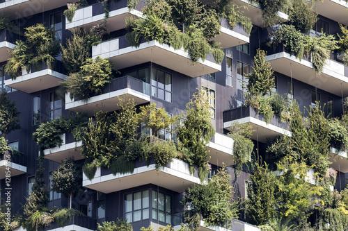 Green futuristic skyscraper; architecture and nature relationship