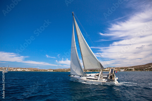 Sailing in the wind through the waves at the Sea. Luxury yacht at race.